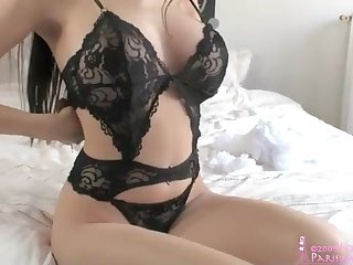 Dark Haired is putting on and taking off her softcore underwear, in front of a web camera